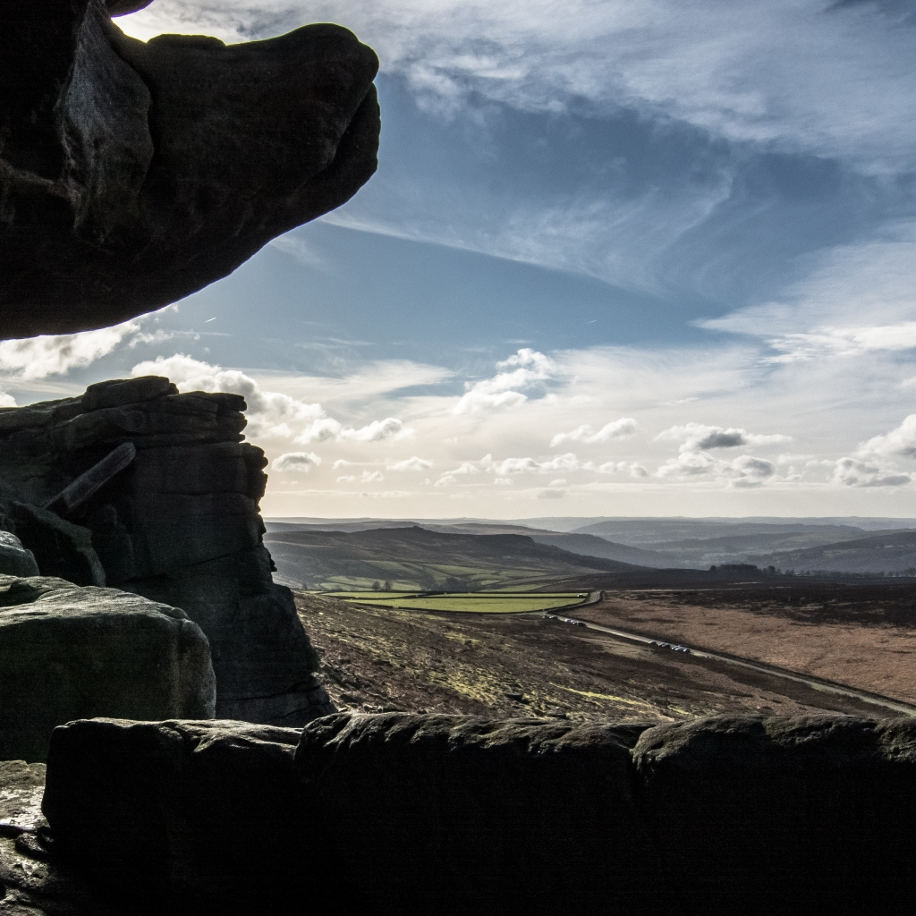 A view out over Stanage Edge from inside Robin Hoods Cave