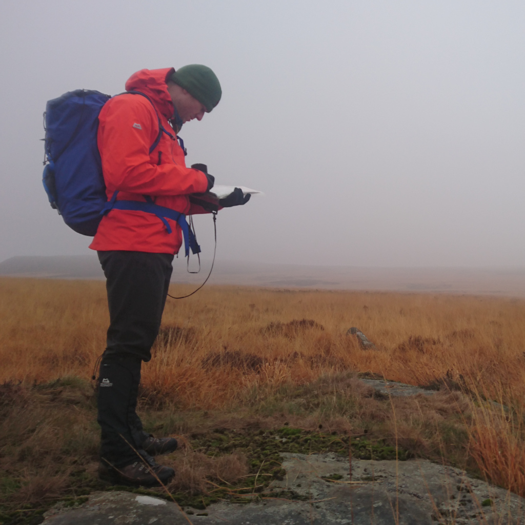 Kial practising navigating across open moorland in the fog