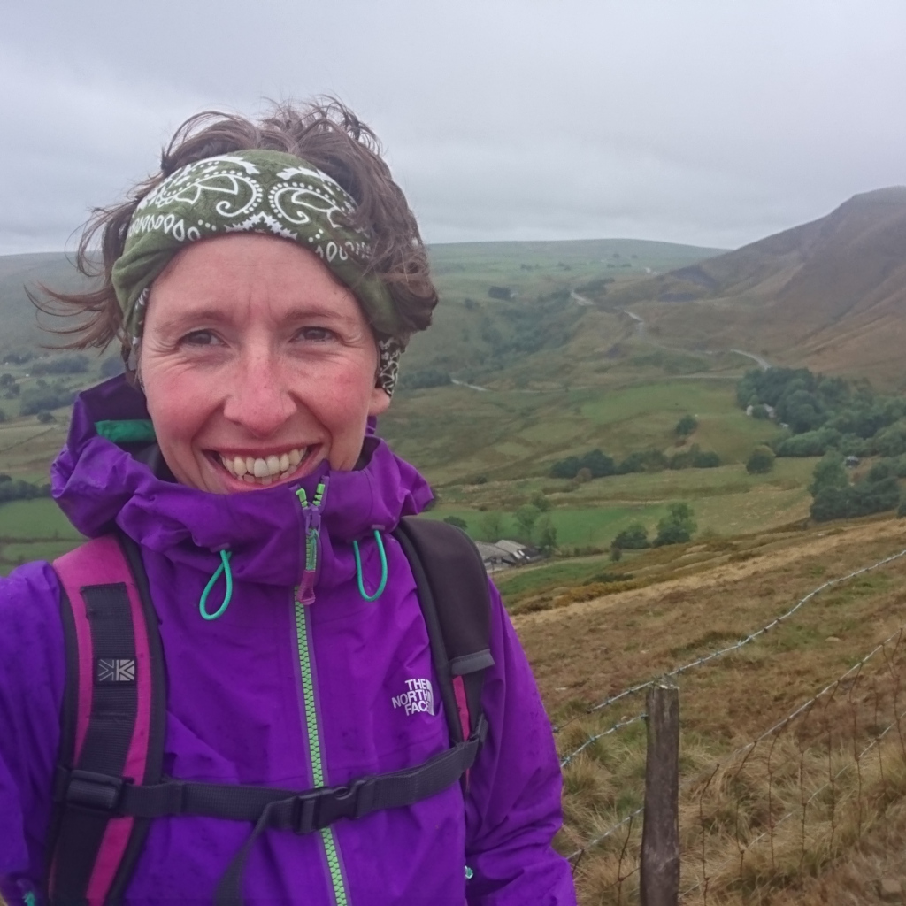 Gemma Scougal looking down into Edale from Rushup Edge in the cloud on a damp day walking Peak District