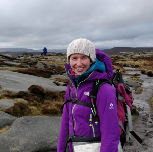 Gemma Scougal navigating to Stanage Edge, Peak District on a cold wet day
