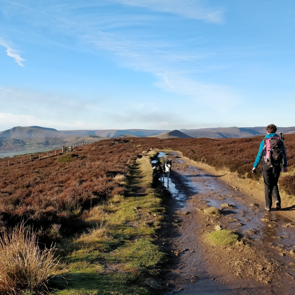 Blue skies as Gemma Scougal walks along Stanage Edge, Peak District
