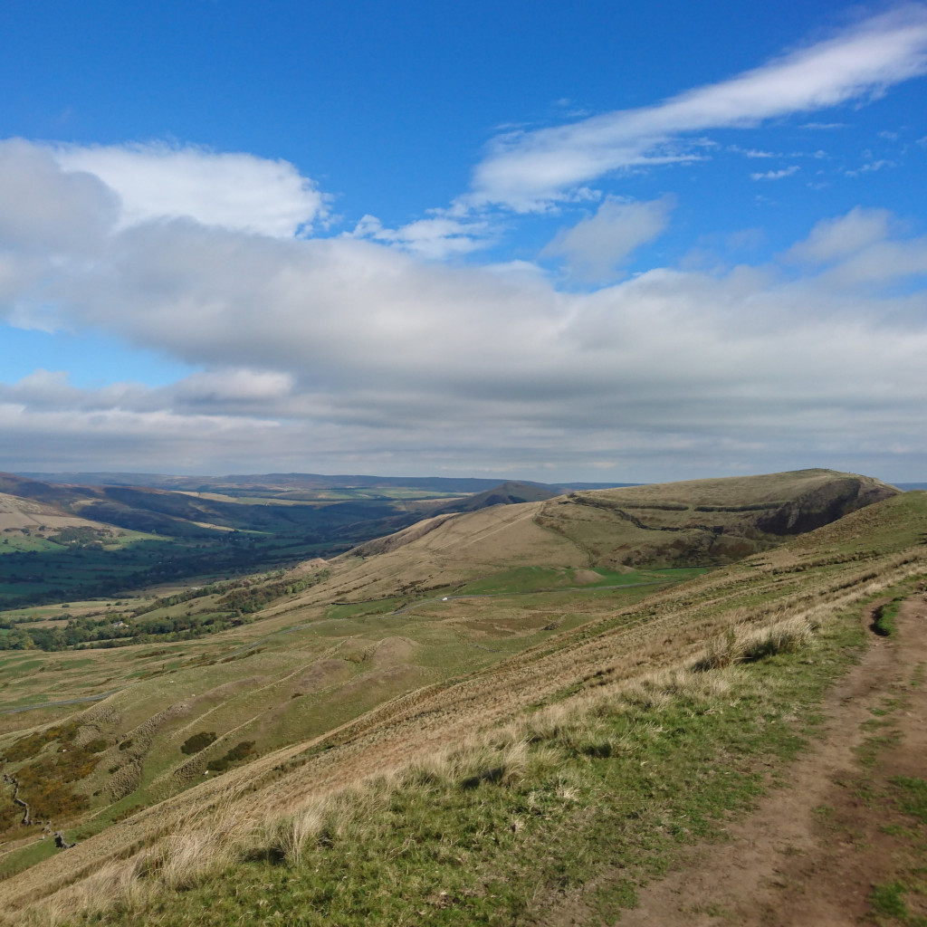 Blue skies along Ruship Edge looking down across moorland and rough grazing into Edale