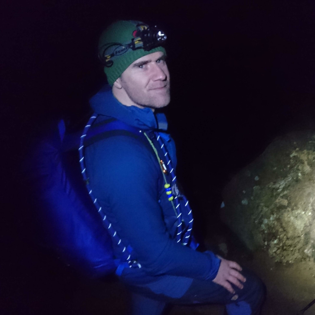 Kial with his head torch on decending at night into Edale