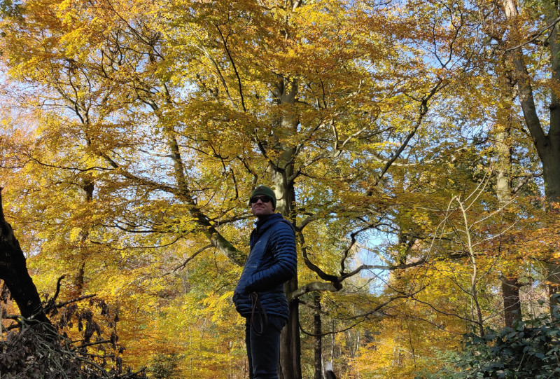 Autumn leaves in Clumber Park with Kial with down jacket and sunglasses
