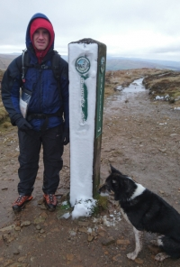 Kial and Lance Superdog and snowy footpath in the Peak District sign